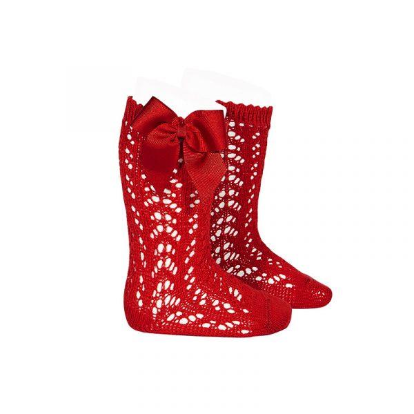 Calcetín alto calado con lazo rojo